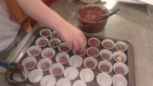 The boys making Peanut Butter Cups